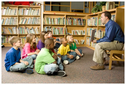 man-reading-to-kids-library